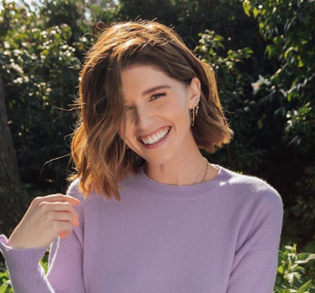 katherine wearing a lavender top smiling