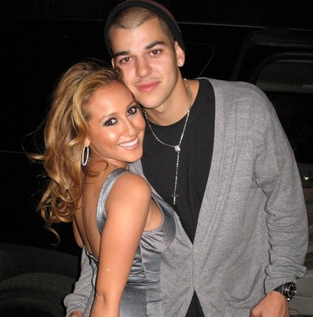 Rob Kardashian and Adrienne Bailon in hugging each other at the picture.