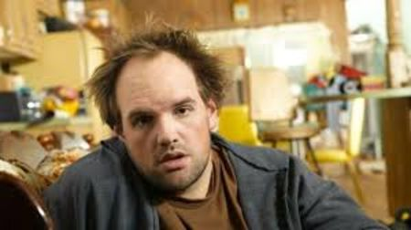 Ethan Suplee in a black jacket poses for a picture.
