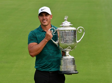 Brooks Koepka lifting the Wanamaker Trophy for the 2018 Majors.