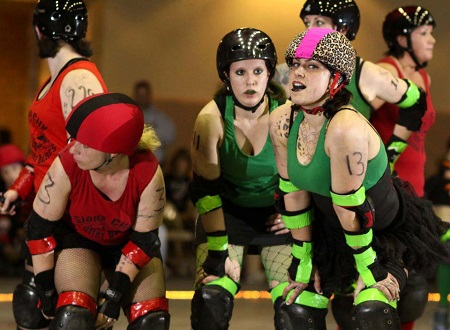 Danielle Colby and her friends during a roller derby warmup.