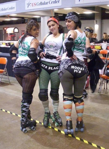 Danielle (right) along with Moly Tov (left) and Danielle's younger sister, Carbomb Betty showing off their advertising assets prior to a Mickies match