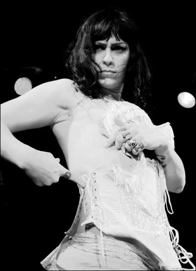 Danielle Colby in midst of a burlesque performance.