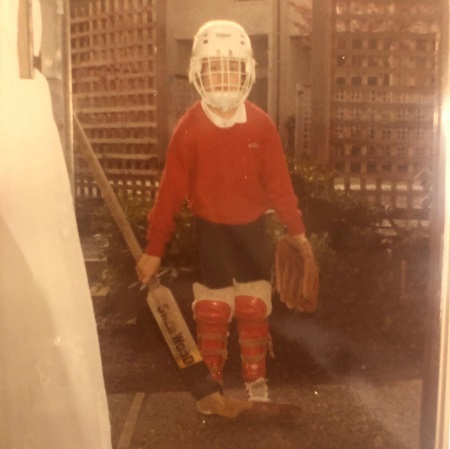 David Lemanowicz as a young boy in an ice hockey outfit with a glove.