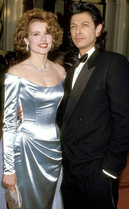 Jeff Goldblum in a black tux poses a picture with actress Geena Davis.
