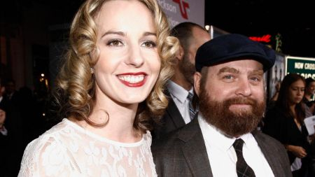 Quinn Lundberg in a white dress alongside husband Galifianakis.
