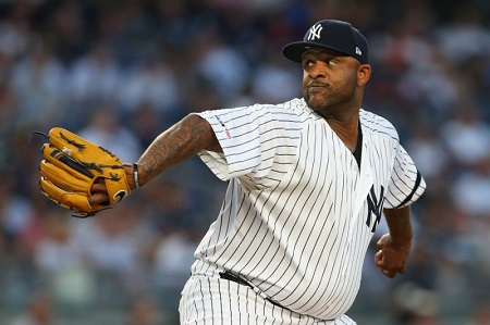 NEW YORK, NY - AUGUST 30: CC Sabathia #52 of the New York Yankees delivers a pitch against the Oakland Athletics during the first inning of a game at Yankee Stadium on August 30, 2019 in New York City.