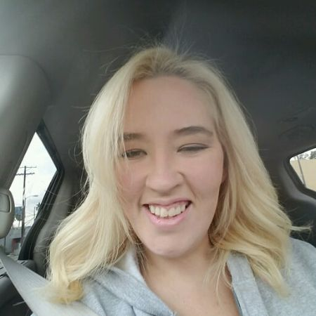 Mama June Shannon poses a picture inside her car.