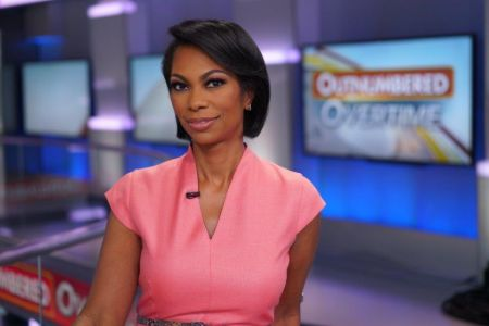 Harris Faulkner gives attention to her looks before she presents herself before camera.