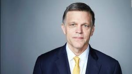 Douglas Brinkley in a black suit poses for a picture.