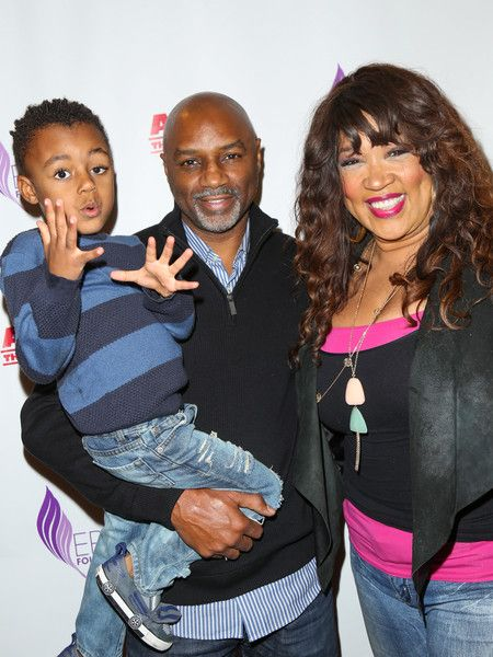 Kym Whitley poses a picture with Rodney Van Johnson and their son.