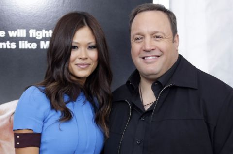 Kevin James in a black suit poses a picture with wife Steffiana de la Cruz.