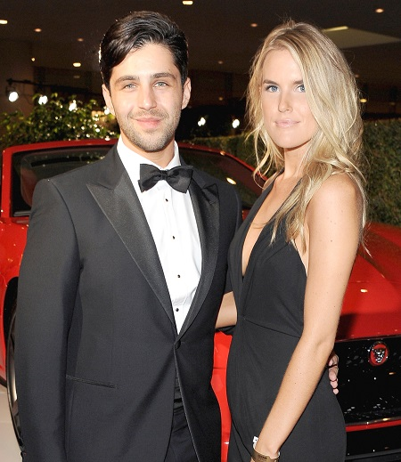Actor Josh Peck (L) and wife Paige O'Brien with the Jaguar F-TYPE Convertible at the 2014 BAFTA LA Jaguar Britannia Awards with Jaguar North America at The Beverly Hilton Hotel on October 30, 2014 in Beverly Hills, California.