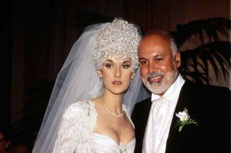 Celine Dion in a wedding gown poses with her husband Rene Angelil.