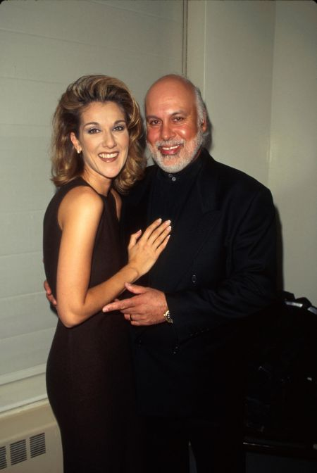 Celine Dion in a black dress poses with her husband Rene Angelil
