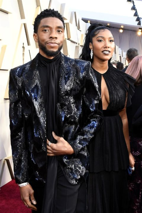 Taylor Simone Ledward and her late husband Chadwick Boseman twinning in a black dress.