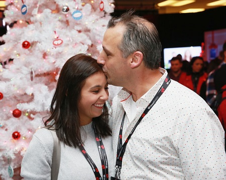 Joseph Gatto kissing his wife, Bessy Gatto's forehead while attending Z100's Jingle Ball 2018 Gift Lounge at Madison Square Garden on December 7, 2018, in New York City.