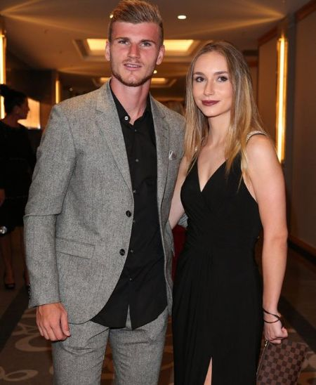 Timo Werner and his girlfriend Julia Nagler pose for a picture.