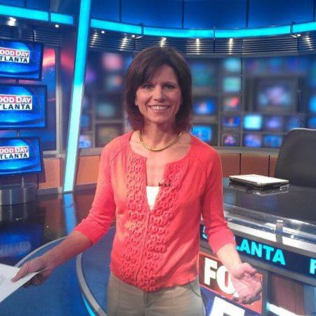 Denise Dillon poses at the studio of Fox 5.