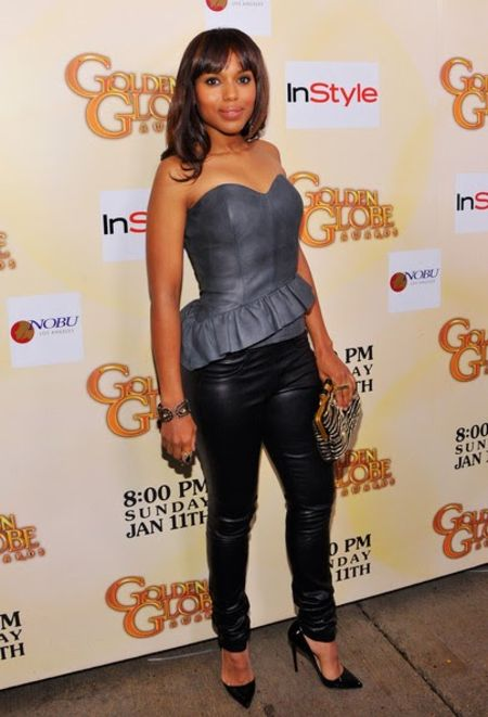 Kerry Washington in a grey top and black pants poses for a picture.