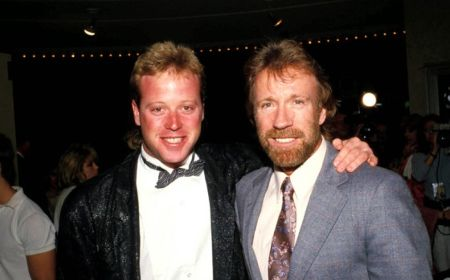 Chuck Norris with his first son Mike Norris at an event