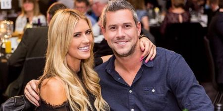 Christina and her present husband Ant Anstead holding each other by shoulder for photo