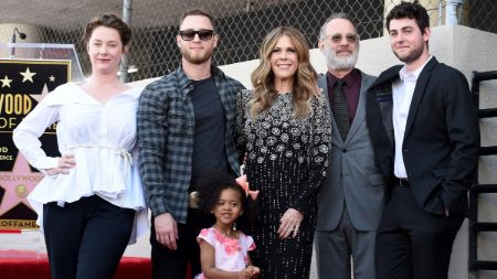 family photo of Wilson with her husband ,sons and daughter inlaw