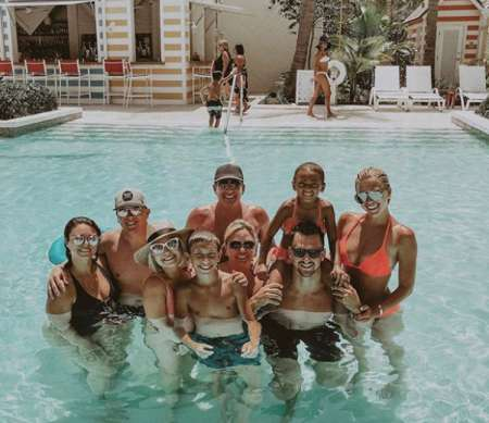 Julie Chrisley enjoying at pool with her husband, son and daughters.